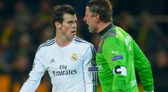 Gareth Bale of Real Madrid exchanges words with goalkeeper Roman Weidenfeller of Borussia Dortmund during the UEFA Champions League Quarter Final second leg match between Borussia Dortmund and Real Madrid