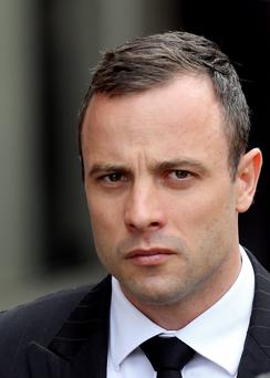 Oscar Pistorius arrives at the high court in Pretoria, South Africa, Wednesday, April 9, 2014