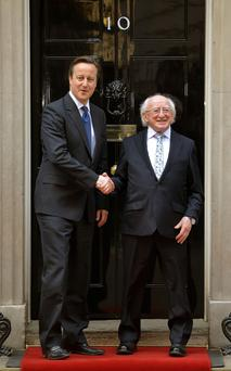 Prime Minster David Cameron welcomes the President of the Republic of Ireland Michael D Higgins to Downing Street. Photo: John Stillwell/PA Wire