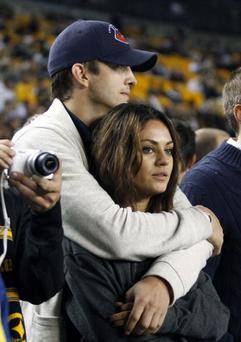 Ashton Kutcher and Mila Kunis look on from the sidelines before the game between the Chicago Bears and the Pittsburgh Steelers last September. (Photo by Justin K. Aller/Getty Images)