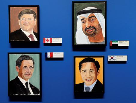 "Portraits of world leaders (clockwise from top-left) Canadian Prime Minister Stephen Harper, Crown Prince of Abu Dhabi Mohamed bin Zayed Al Nahyan, former French President (2007-2012) Nicolas Sarkozy and former South Korean President (2008-2013) Lee Myung-bak, painted by former U.S. President George W. Bush, hang on display during ""The Art of Leadership: A President's Personal Diplomacy"" exhibit REUTERS/Brandon Wade"