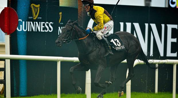 Robbie Power and Missunited on their way to winning Galway Hurdle Handicap at Ballybrit