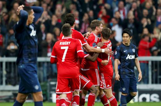 Bayern Munich's Thomas Mueller (C) celebrates with team mates after scoring a goal against Manchester United during their Champions League quarter-final second leg soccer match in Munich, April 9, 2014. REUTERS/Michaela Rehle