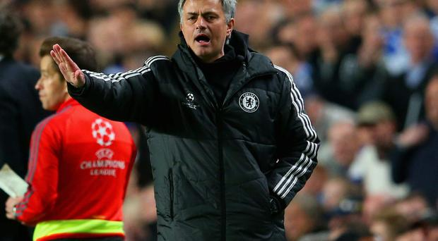 Jose Mourinho instructs his players during their victory against Paris Saint Germain