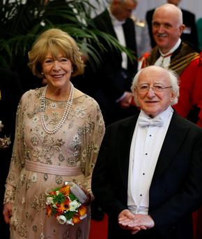 President of Ireland Michael D Higgins and his wife Sabina Coyne arrive to attend a banquet in the Presidents honour at The Guildhall, in London, Wednesday, April 9, 2014. (AP Photo/Kirsty Wigglesworth)
