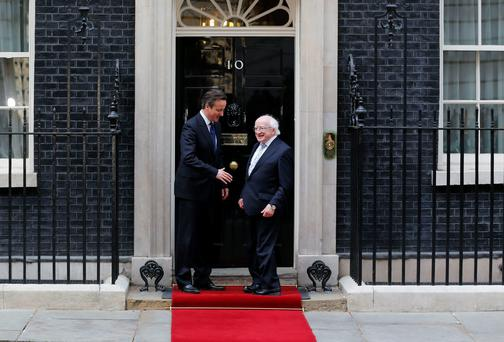 Britain's Prime Minister David Cameron greets President Michael D. Higgins as he arrives at Number 10 Downing Street