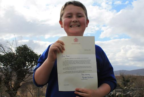 Ten year old Naoise Barker with his letter from Buckingham Palace.