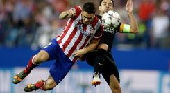 Atletico's Koke, left, has been a star performer for Atletico this season.