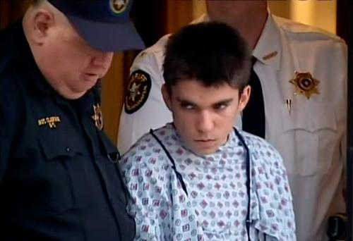 A still image from video footage courtesy WPXI-TV shows stabbing suspect Alex Hribal dressed in a hospital gown after his arraignment with Sheriff's deputies in Export, Pennsylvania
