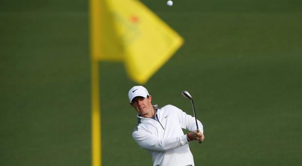 Northern Ireland's Rory McIlroy hits onto the second green during a practice round ahead of the Masters