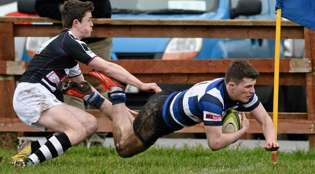 Calvin Nash - pictured scoring for Crescent College Comprehensive in the SEAT Munster Schools' Senior Cup - has earned a call-up to the Ireland U-18 Schools squad