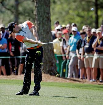 Rory McIlroy, of Northern Ireland, hits on the first fairway during the first round of the Masters golf tournament. (AP Photo/Darron Cummings)