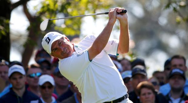 Fred Couples hits his tee shot on the fourth hole during the first round of the Masters golf tournament at the Augusta National Golf Club in Augusta
