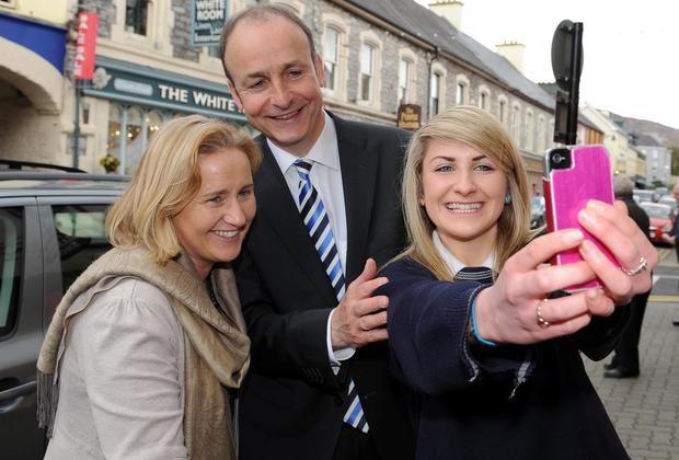 Fianna Fail leader Micheal Martin and local election candidate Norma Moriarty join student Eimear Fitzgerald for a selfie in Kenmare, Co Kerry. Picture: EAMONN KEOGH