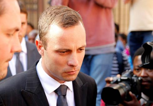 Oscar Pistorius reacts at the end of his trial at the North Gauteng High Court in Pretoria April 10, 2014. Reuters