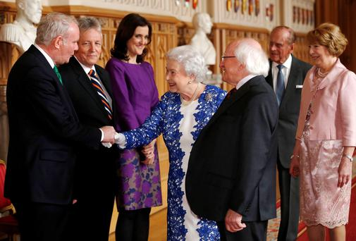 It was another significant gesture during a state visit that meant so much – in the Great Hall at Windsor Castle, the North's Deputy First Minister Martin McGuinness warmly shook the hand of Britain's Queen Elizabeth, watched by First Minister Peter Robinson and President Michael D Higgins. Photo: PA