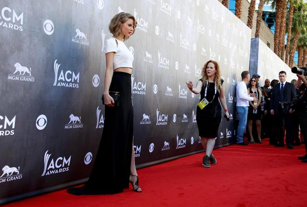 Country music artist Taylor Swift poses as she arrives at the 49th Annual Academy of Country Music Awards in Las Vegas