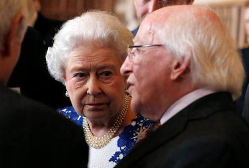 Queen Elizabeth and President Michael D Higgins attend a Northern Ireland-themed reception at Windsor Castle at Windsor. The event was organised as part of Higgins' four-day state visit. Reuters