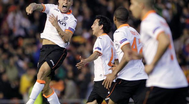 Valencia's Eduardo Vargas (L) celebrates with teammates after he scored against FC Basel during their Europa League quarter-final win last night