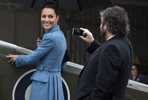 Catherine, Duchess of Cambridge poses for director Peter Jackson during a visit Omaka Aviation Heritage Centre. Photo: Ian McGregor