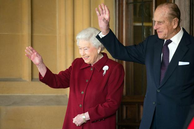 Britain's Queen Elizabeth and Prince Philip bid farewell to the President of Ireland Michael D Higgins and his wife Sabina at Windsor Castle