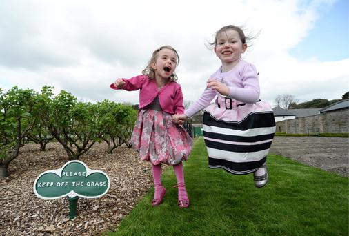 Saoirse Bergin (4) left, and Cora Cronin (4), from Dublin 7, enjoy the dry weather in the Phoenix Park in Dublin. The dry weather is predicted to last for the first week of the Easter holidays at least. Picture: Caroline Quinn