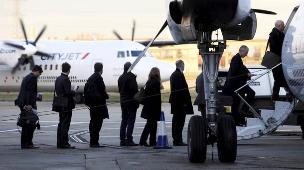Passengers queue to board an aircraft operated by CityJet at City Airport in London. Photo: Chris Ratcliffe/Bloomberg
