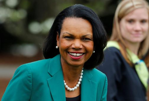 Former US Secretary of State Condoleezza Rice wears her green jacket as she attends the Drive Pitch and Putt contest before the Masters golf tournament at the Augusta National Golf Club. Reuters