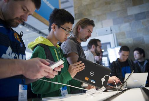 Attendees try out devices during the Microsoft Developers Build Conference in San Francisco earlier this month. Photo: Bloomberg