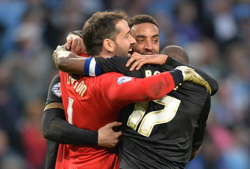 Wigan Athletic goalkeeper Scott Carson - pictured with his team-mates after their quarter-final win over Manchester City - says there is 'no bigger competition' for him than the FA Cup