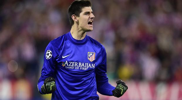 Atletico Madrid's Belgian goalkeeper Thibaut Courtois celebrates after the UEFA Champions League quarter final football match Club Atletico de Madrid vs Barcelona at the Vicente Calderon stadium in Madrid on April 9, 2014. AFP PHOTO / JAVIER SORIANO (Photo credit should read JAVIER SORIANO/AFP/Getty Images)