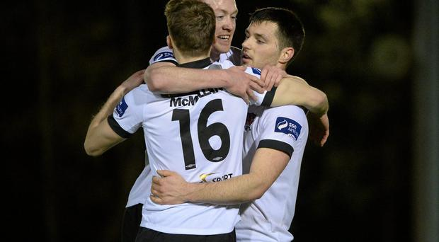 Dundalk's Patrick Hoban (right) celebrates his goal against UCD with team-mates Chris Shields and David McMillan during last night's clash in Dublin