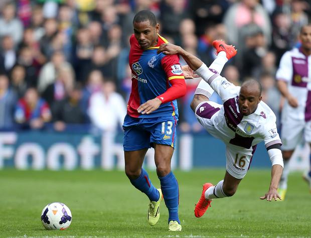 Crystal Palace's Jason Puncheon battles for possession of the ball with Aston Villa's Fabian Delph at Selhurst Park.
