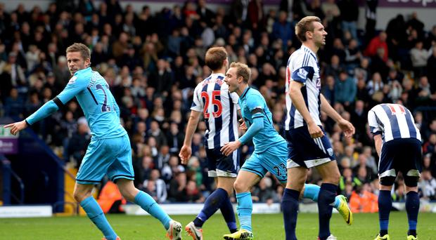 Christian Eriksen celebrates after scoring his team's third goal deep in injury time at The Hawthorns.