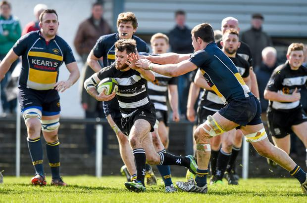Aaron Sheehan, Old Belvedere escapes a tackle by Miah Cronin, Dolphin