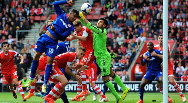 Goalkeeper Paulo Gazzaniga of Southampton punches clear from the head of Fraizer Campbell of Cardiff
