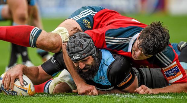 Glasgow Warriors's Josh Strauss scores his side's third try despite the efforts of Munster's Donncha O'Callaghan