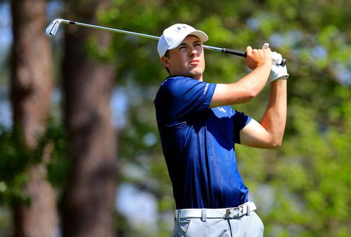 Jordan Spieth watches his tee shot on the fourth hole during the third round of the 2014 Masters Tournament at Augusta. Photo: Getty Images