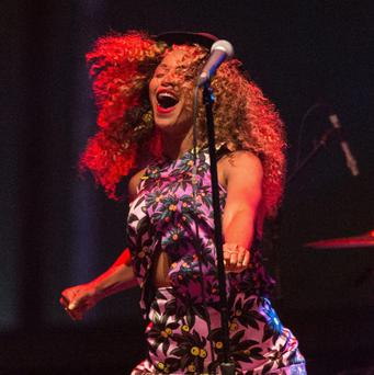 Singer Beyonce performs with her sister Solange onstage during day 2 of the 2014 Coachella