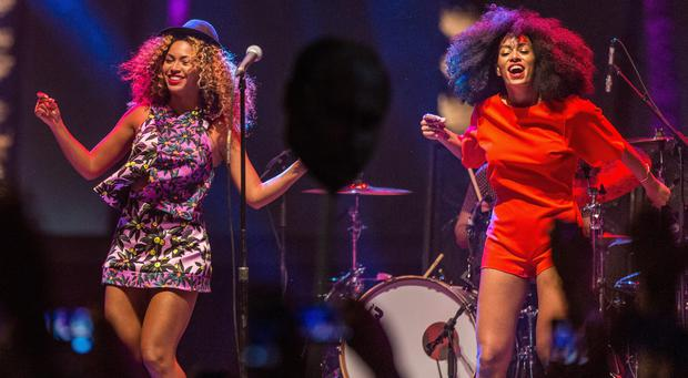 Singer Beyonce (L) performs with her sister Solange onstage during day 2 of the 2014 Coachella