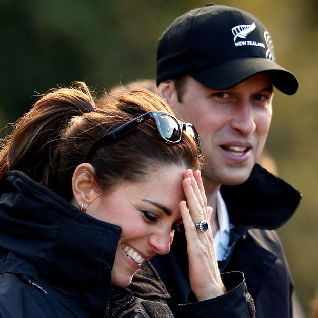Kate Middleton, Duchess of Cambridge, and her husband, Britain's Prince William, laugh before taking a jet-boat ride on the Shotover River in Queenstown