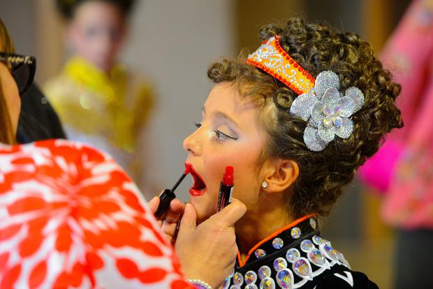A dancer prepares to take part in the World Irish Dancing Championships 2014, at the Hilton London Metropole hotel, in central London. PRESS ASSOCIATION Photo. Picture date: Sunday April 13, 2014. Dancers will compete in solo, ceili, choreography and dance drama categories in a variety of age groups.