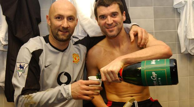 Roy Keane pours champagne with Fabien Barthez as Manchester United celebrate victory after they beat Blackburn Rovers in the 2003 League Cup semi-final