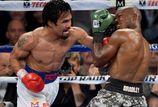 Timothy Bradley and Manny Pacquiao box during their WBO World Welterweight Title bout