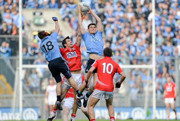 Diarmuid Connolly, Dublin, supported by team-mate Davy Byrne, 18, in action against Jamie O'Sullivan and Mark Collins, 10, Cork