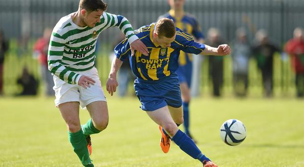 Jimmy Carr, St. Michaels FC, in action against Paul Murphy, Sheriff YC