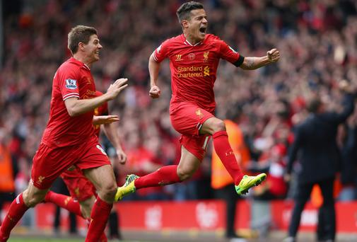 Match-winner Philippe Coutinho celebrates scoring Liverpool's third goal against Manchester City at Anfield