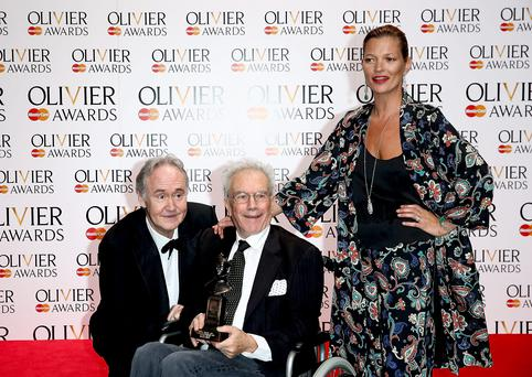 Nigel Planer, Special Award winner Michael White and Kate Moss pose in the press room at the Laurence Olivier Awards at The Royal Opera House on April 13, 2014 in London, England.
