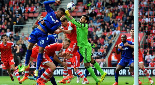Southampton goalkeeper Paulo Gazzaniga punches clear from the head of Cardiff's Fraizer Campbell