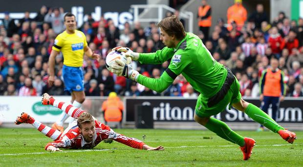 Stoke City's Peter Crouch has his diving header saved by Newcastle United's Tim Krul